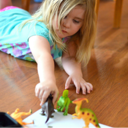 Dinosaur Track Painting With Plastic Dinosaurs